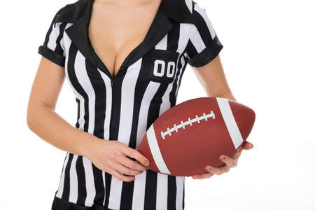 Close-up Of Female Referee Holding American Football Over White Background