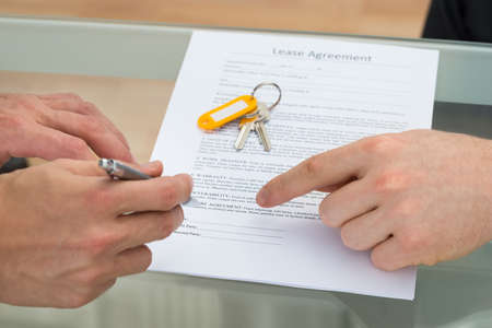 lease: Close-up Of A Person Signing Lease Agreement Stock Photo