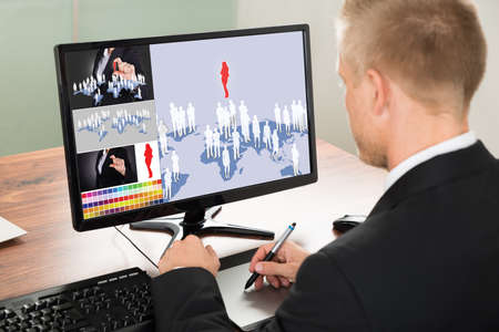 digital printing: Close-up Of A Businessman Using Graphic Tablet For Digital Printing.