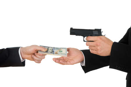 giving money: Businessman Hand Giving Money To A Person Aiming With Gun Over White Background Stock Photo
