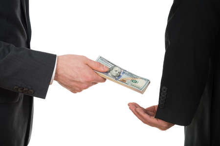 bribe: Close-up Of A Businessman Taking Bribe Over White Background Stock Photo