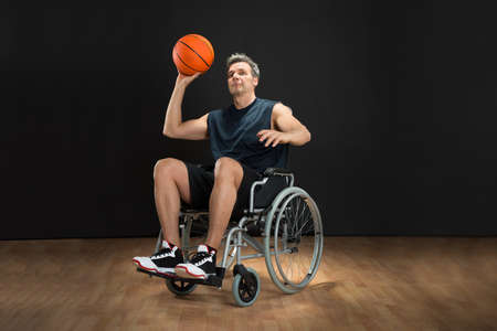 disable: Disabled Basketball Player On Wheelchair Throwing Ball Stock Photo