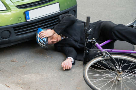 Unconscious Male Cyclist Lying On Road After Road Accident