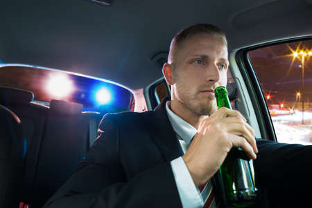 Young Man Drinking Beer And Pulled Over By Police