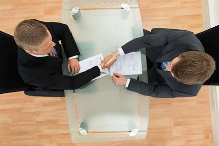 job opening: Elevated View Of Two Businessman Shaking Hands In The Office