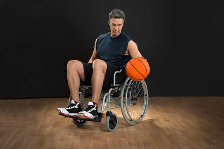disabled: Disabled Basketball Player On Wheelchair Throwing Ball Stock Photo