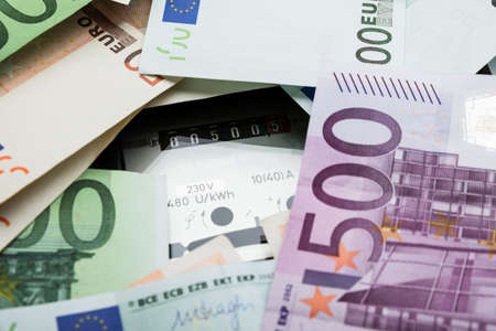 electricity meter: Close-up Of A Euro Banknotes Over Electricity Meter