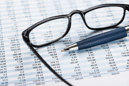 accounts: View Of Financial Document From Transparent Eyeglasses