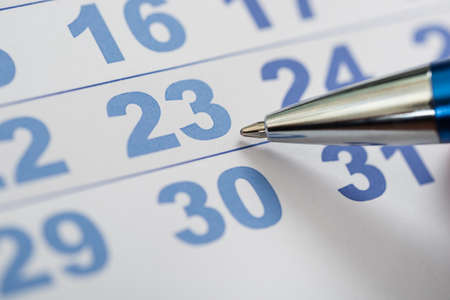 daily planner: Close-up Photo Of Pen Nib On Calendar