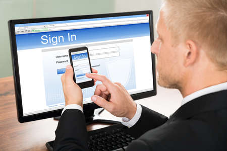 pointing device: Close-up Of A Businessman Signing In Email Account Using Smartphone