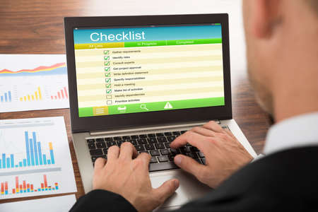 male wood tick: Close-up Of A Businessman Filling Checklist Form On Laptop