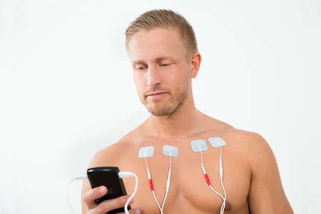 therapeutics: Portrait Young Man With Electrodes On Chest