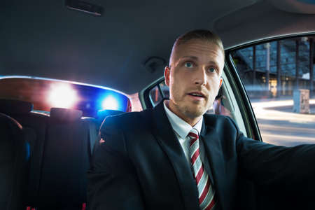 Portrait Of A Young Scared Man Pulled Over By Police