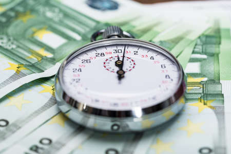 timekeeping: Close-up Of A Stopwatch On Euro Banknotes