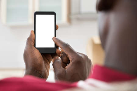 mobile devices: Close-up Photo Of  African Man Holding Cellphone