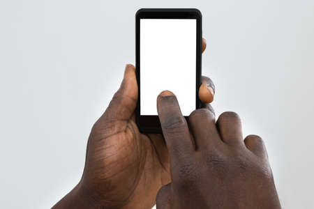 Close-up Of Persons Hand Using Cellphone With Blank Screen Imagens