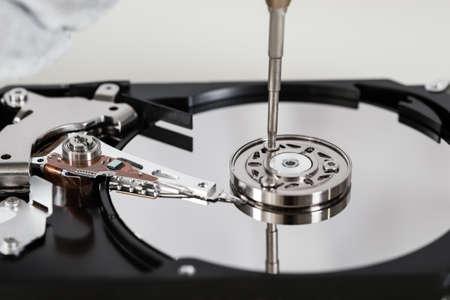 harddisk: Close-up Of Open Harddisk Repair With Screwdriver