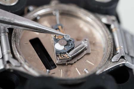 tweezers: Close-up Photo Of Tweezers Repairing Wrist Watch