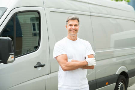 painter: Happy Male Painter With Arms Crossed Standing In Front Of Van