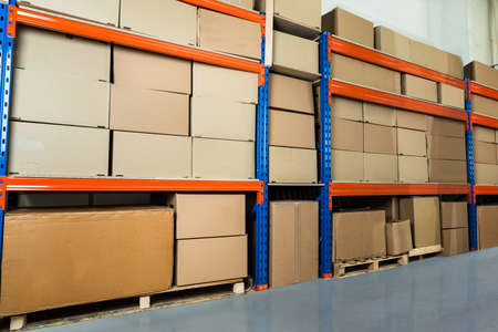 distribution box: Cardboard Boxes On Shelves In Distribution Warehouse
