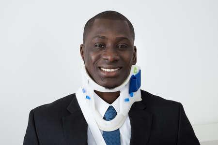 Portrait Of Happy African Businessman With Neck Brace