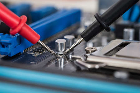 test equipment: Close-up Photo Of Multimeter And Motherboard Repair