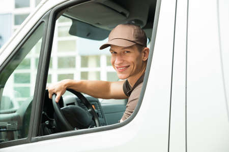 delivery: Young Happy Delivery Man Driving Service Delivery Van