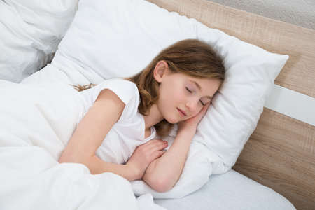sleeping girl: Cute Girl Sleeping With White Blanket In Bed