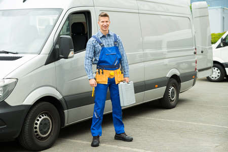 toolbox: Young Repairman With Tools And Toolbox Standing In Front Of Service Van