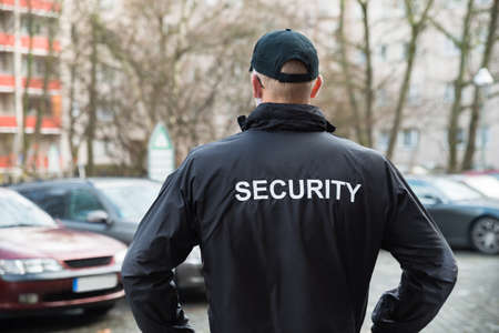 Close-up Of Male Security Guard Wearing Black Jacket Stockfoto