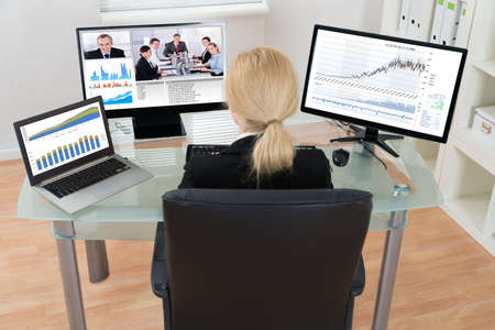 Young Businesswoman Video Conferencing With Colleagues On Computer