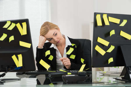 sticky: Tired Businesswoman With Adhesive Notes Sitting In Office