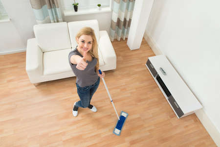 angle views: High Angle View Of Young Woman Mopping Floor At Home