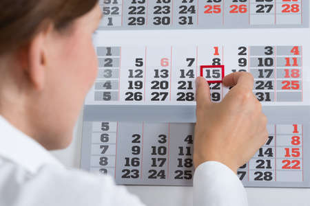 important date: Close-up Of Businessperson Marking Important Date On Calendar