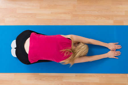 high angle: High Angle View Of Woman In Sportswear Exercising At Home