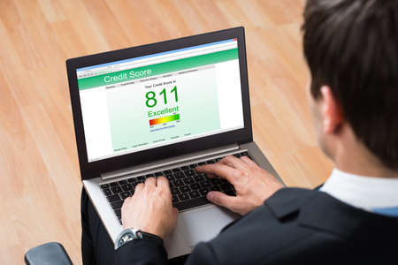 credit score: Close-up Of Businessperson Checking Online Credit Score Record On Laptop In Office