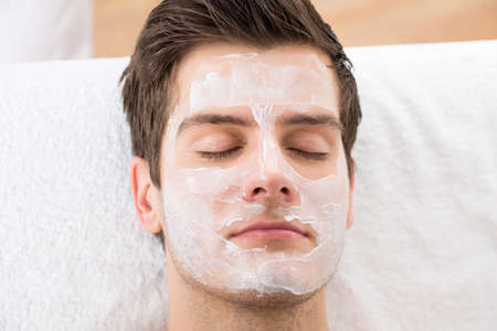 Face Mask Applied To A Young Man In A Spa