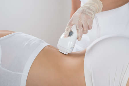beauty center: Young Woman Getting Epilation Laser Treatment At Beauty Center