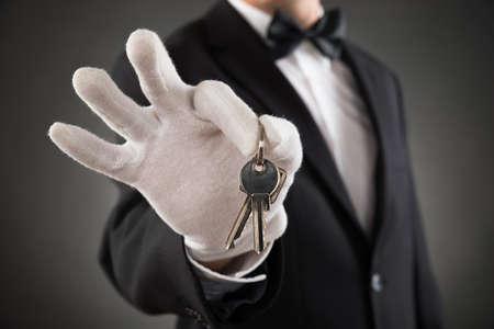 waiter: Close-up Of Waiter Hands Wearing Glove Holding Keys