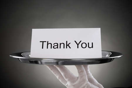 butler: Close-up Of Waiter Holding Plate With The Text Thank You On Paper