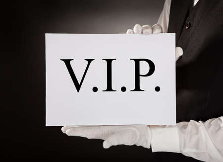 Close-up Of Waiter In Uniform Holding Board With The Text Vip