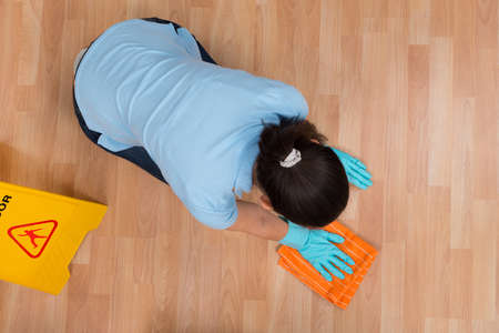 floor cloth: High Angle View Of Woman Rubbing Wooden Floor With Cloth