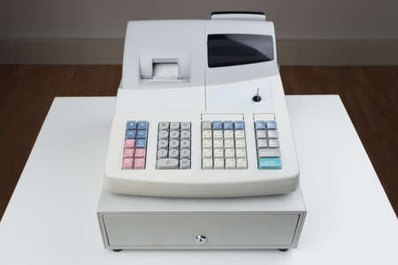 cash register: Close-up Of Electronic Cash Register Moneybox On Counter