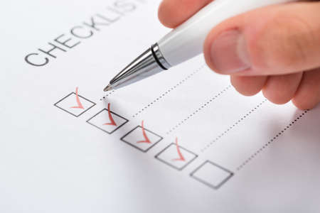 tickbox: Close-up Of Silver Pen Over Filled Checkboxes In Form Stock Photo