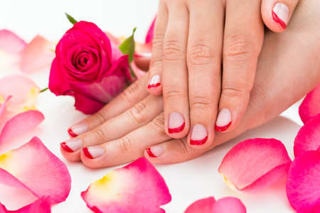 nailart: Close-up Of Female Hands With Manicured Red Nail Varnish