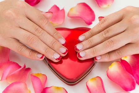 nailart: Close-up Of Woman Hands With Nail Varnish On Red Make-up Box