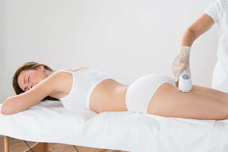 depilation: Close-up Of Woman Lying And Receiving Laser Hair Removal Treatment