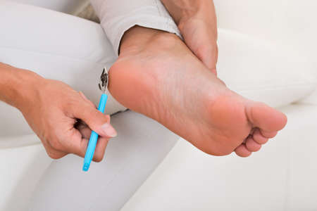 filing: Close-up Of Woman Filing Foot With Foot File
