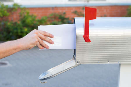 mailbox: Close-up Of Person Removing Yellow Letters From Mailbox