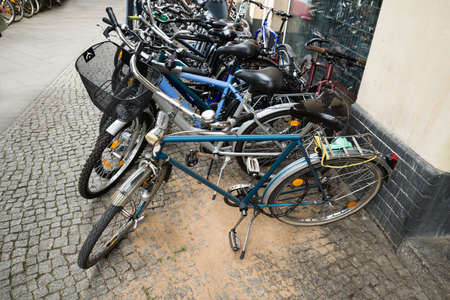 sidewalk sale: Group Of Bikes Parked In A Row In A Parking Lot